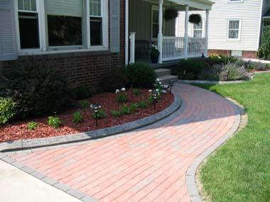 Decorative Curb along brick path installed by the customer